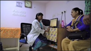 Nalla Swanpna Cardiology PA in India talks to a patient 2017